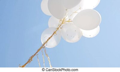 inflated white helium balloons in blue sky 2 - holidays,...