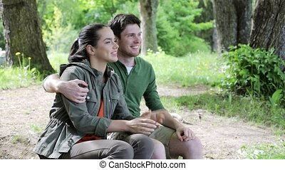 happy young man giving flower to woman outdoors 11 -...