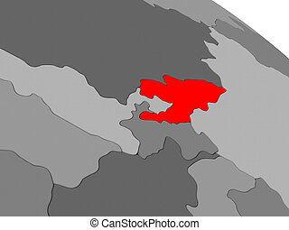 Kyrgyzstan highlighted in red on model of globe. 3D...