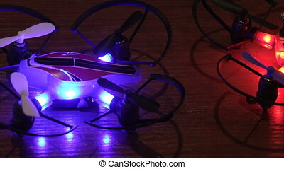 Flashing lights of two colors - Bokeh two small copter blue...