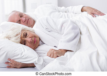 Sharing of dreams in one bed - Older married couple lie in...