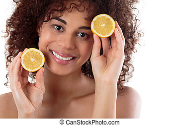 Perfect source of vitamine C - Shot of a young happy woman...