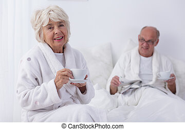 Morning coffee with beloved one tastes best - Smiled old...