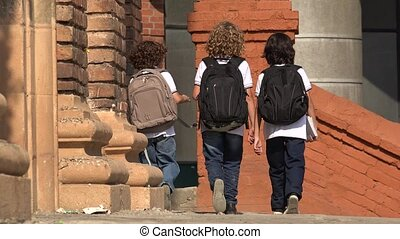 Elementary School Kids Walking With Backpacks
