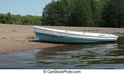 rowing boat on the beach - Empty rowing on the sandy shore...