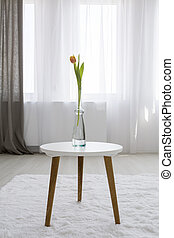 Perfect subtle decor - Shot of a table with a tulip in a...