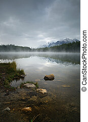 Lake Herbert in a foggy morning with glaciers mountain and...