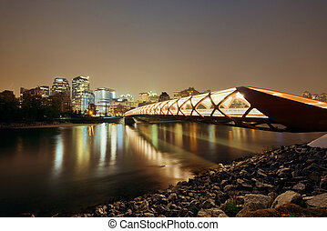 Calgary cityscape with Peace Bridge and downtown skyscrapers...
