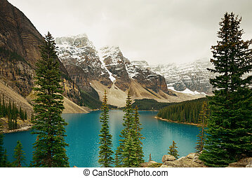 Moraine Lake with snow capped mountain of Banff National...