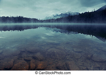 Lake Herbert with morning fog snow glacier mountain