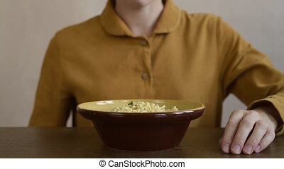 Woman eating quick-dissolving noodles - Woman eating a...