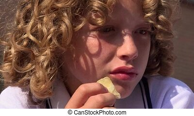 Boy Eating Potato Chips