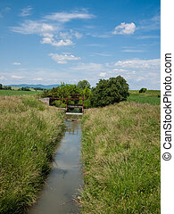 Floodgate on the river - Irrigation canal with open sluice...