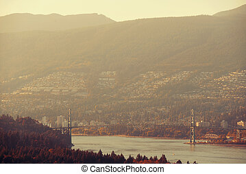 Lions Gate Bridge at sunset in Vancouver Canada