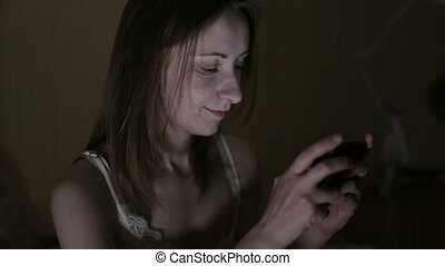 Attractive, young woman browsing photos or internet