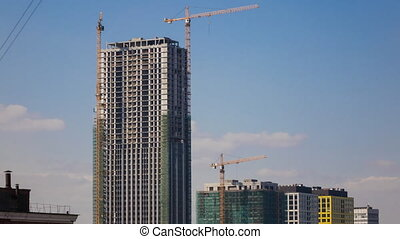 Time lapse video of clouds and construction site in Moscow,...