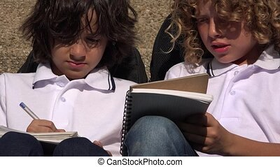 Young Students Thinking And Writing