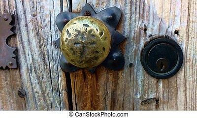 Bronze Doorknob - Doorknob on an old door at the Presidio La...