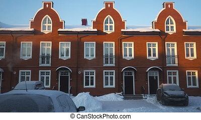 Morning shadow moving on red brick townhouses, time lapse....