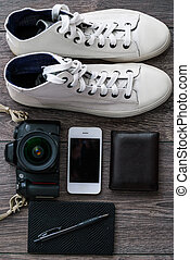 Outfit of traveler or student. Overhead of essentials for...