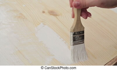 Wood painting with a brush