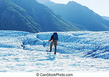 Hiker on glacier - Hike in Wrangell-St Elias National Park,...