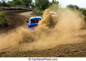 Cars on the autocross. Racing in the open air with dust....