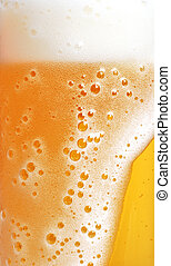 close up of beer with foam