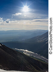 Panorama of mountains, arid wild landscape and blue sky