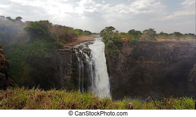 The Victoria falls is the largest curtain of water in the...