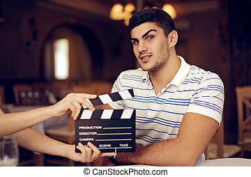 Actor Raising his Eyebrow - Portrait of a handsome man a...