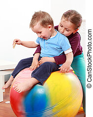 Lot of fun with gymnastic ball - Kids have a fun with the...