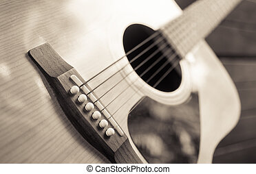 detail of classic guitar with shallow depth of field (vintage filter)