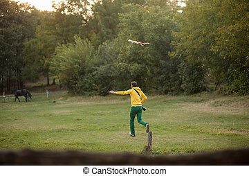 man flying a kite in the sun