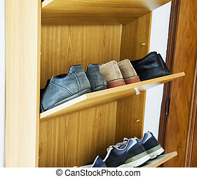 Shoes in a shoe rack, multilevel, horizontal image