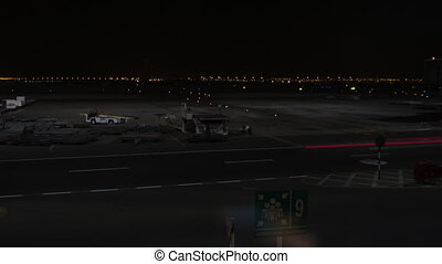 Abu Dhabi airport at night. Time lapse video clip