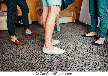 group of boys standing in the room on carpet