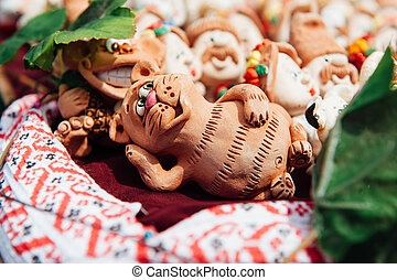 many Ukrainian souvenirs - clay figurines cat - many...