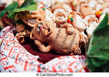 many Ukrainian souvenirs - clay figurines cat - many...