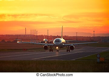 Airport traffic at the sunset - Airport traffic at the...