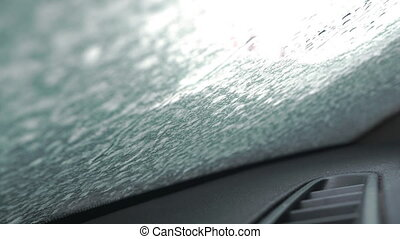 Snow thawing on a windshield of a car. Timelapse video -...