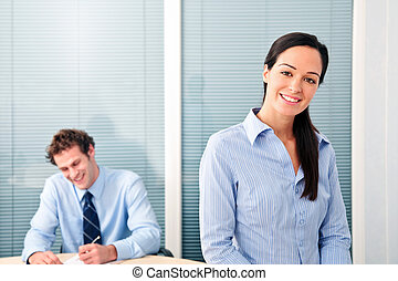 Happy office workers - Male and female office workers, she...