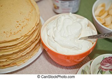 Whipped cream is cream that has been beaten by a mixer,...