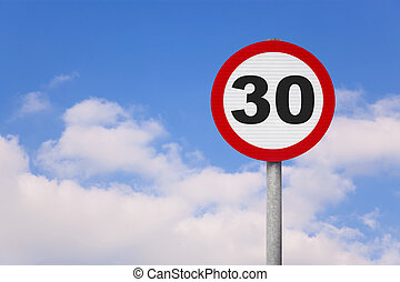 Round roadsign with the number 30 - A round roadsign with...