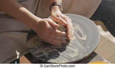Woman tries to learn craftsmanship pottery to create clay...