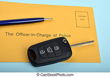 car key and police postag envelope