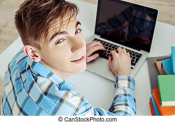 Cute young student using laptop - Modern problem: youth and...