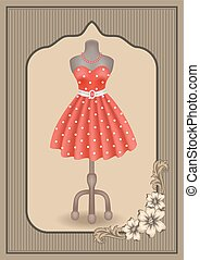 Dress with polka dots on dummy on showcase in vintage frame with flowers ornament
