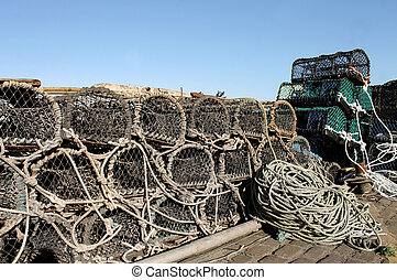 Lobster pots and fishing nets on a harbor quayside