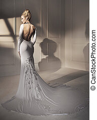 Portrait of an attractive blond lady wearing a fabulous gown